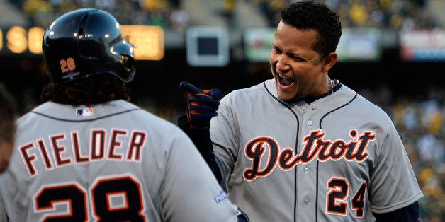 OAKLAND, CA - OCTOBER 10:  Miguel Cabrera #24 celebrates his two-run home run with Prince Fielder #28 of the Detroit Tigers i