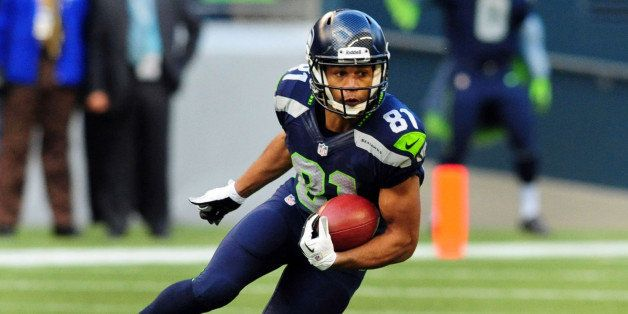 SEATTLE, WA. - NOVEMBER 03: Wide receiver Golden Tate #81 of the Seattle Seahawks returns a punt during the third quarter of