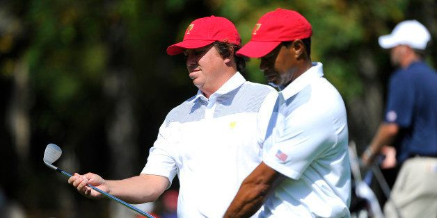 DUBLIN, OH - OCTOBER 01:  Jason Dufner and Tiger Woods of the U.S. Team walks the fairway during a practice round prior to th