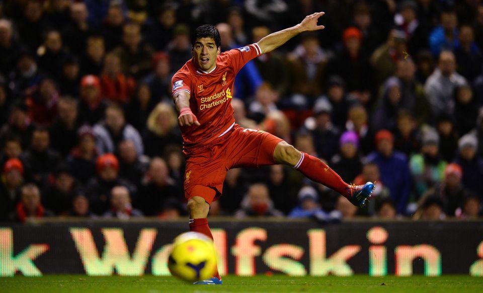 Liverpool's Uruguayan striker Luis Suarez shoots towards goal during the English Premier League football match between Liverp
