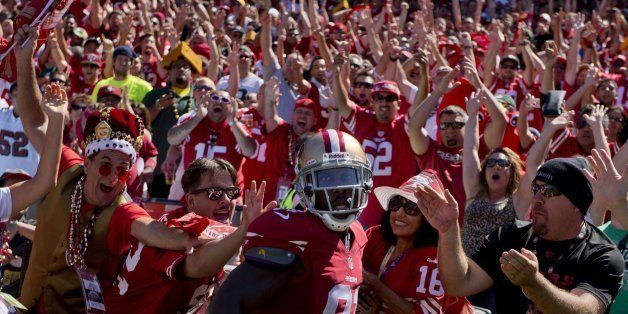 San Francisco 49ers wide receiver Anquan Boldin celebrates with fans after a ten-yard touchdown catch in the second quarter a