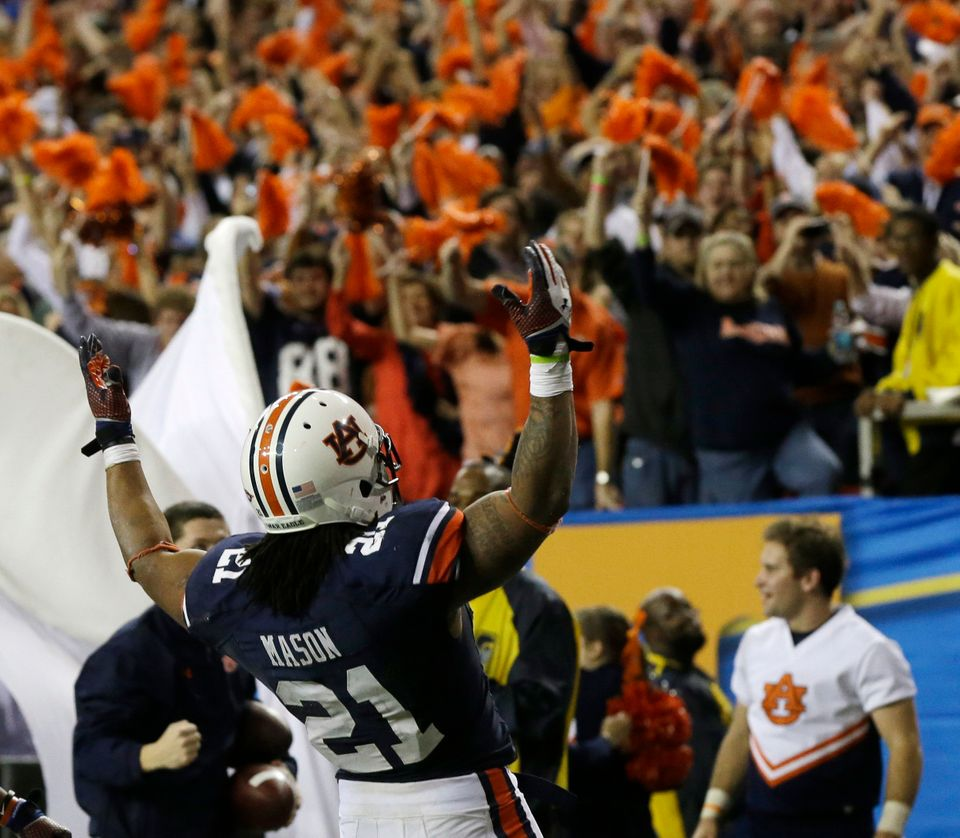 Auburn running back Tre Mason (21) celebrates his touchdown against Missouri during the second half of the Southeastern Confe
