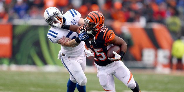 CINCINNATI, OH - DECEMBER 08:  Giovani Bernard#25 of the Cincinnati Bengals runs with the ball while defended by Pat Angerer#