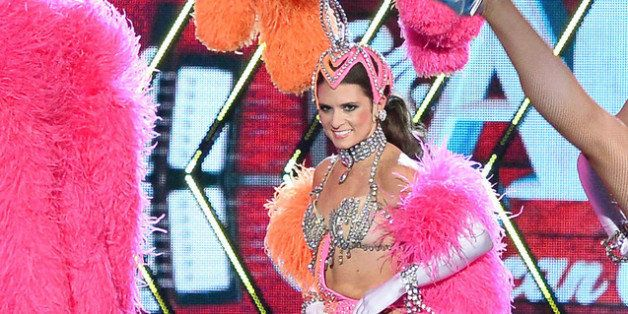 LAS VEGAS, NV - DECEMBER 10:  NASCAR driver Danica Patrick performs dressed as a showgirl from the 'Jubilee!' show as she co-