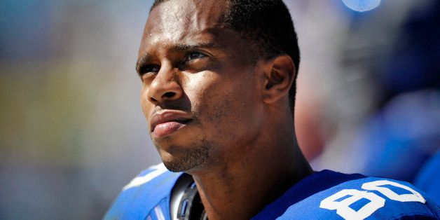 CHARLOTTE, NC - SEPTEMBER 22: Wide receiver Victor Cruz #80 of the New York Giants looks on during a NFL game against the Car