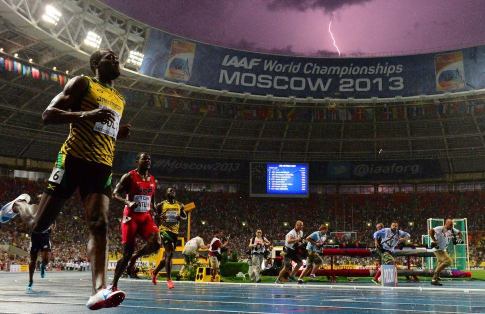 Jamaica's Usain Bolt wins the 100-meter final at the 2013 IAAF World Championships at Luzhniki Stadium, just as lightning str