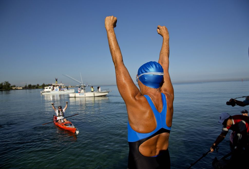 U.S. swimmer Diana Nyad, 64, greets her support team before her swim to Florida from Havana. The endurance athlete made histo