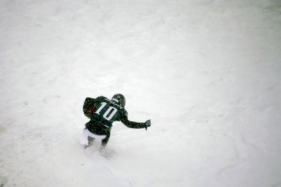 Philadelphia Eagles' DeSean Jackson celebrates in the snow after a touchdown during the second half of an NFL football game a