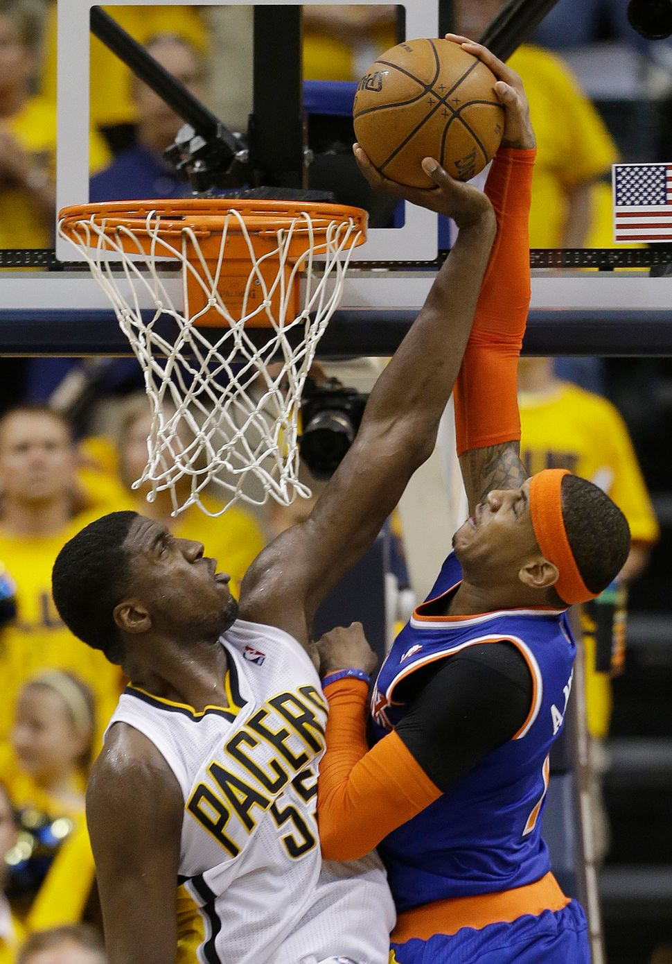 Indiana Pacers' Roy Hibbert blocks a shot from the New York Knicks' Carmelo Anthony, right, during the Eastern Conference Sem