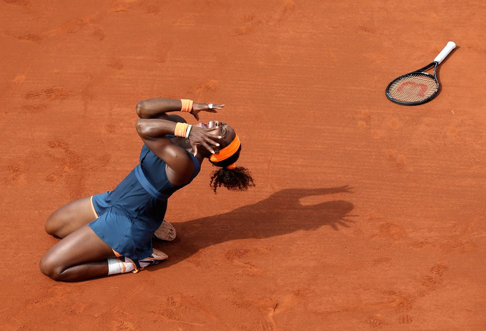 Serena Williams celebrates as she defeats Russia's Maria Sharapova during the women's final match of the French Open at the R