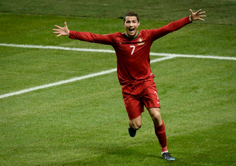 Portugal's Cristiano Ronaldo celebrates after scoring the winning goal during the World Cup 2014 qualifying playoff between S
