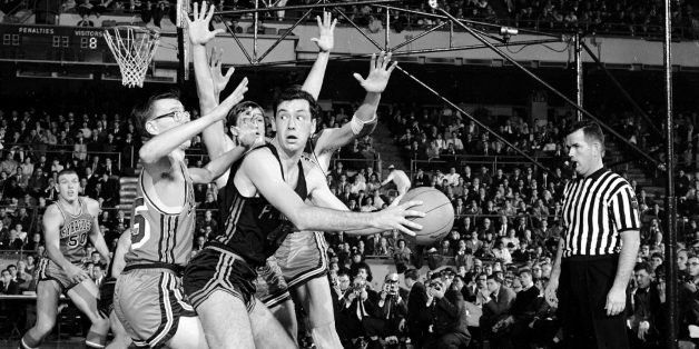 UNITED STATES - DECEMBER 28:  Bill Bradley (r.) of Princeton is guarded by Syracuse's Jim Boeheim (l.) and Frank Nicoletti (h