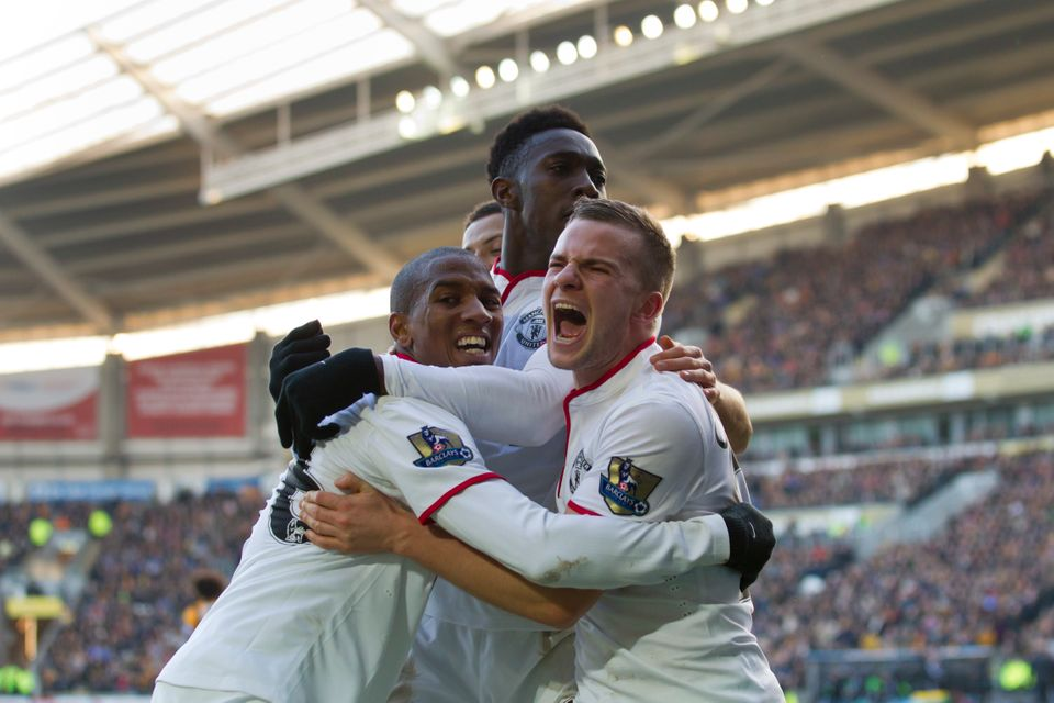 Manchester United's Ashley Young, left, celebrates with teammates after forcing an own goal by Hull City's James Chester duri