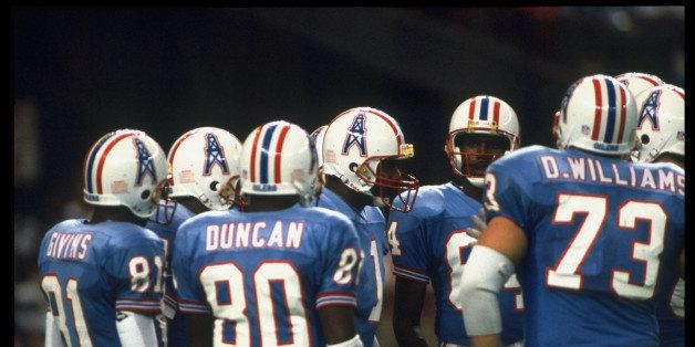 Football: Houston Oilers QB Warren Moon #1 in huddle w. teammates during game vs KC Chiefs.  (Photo by William Snyder//Time L