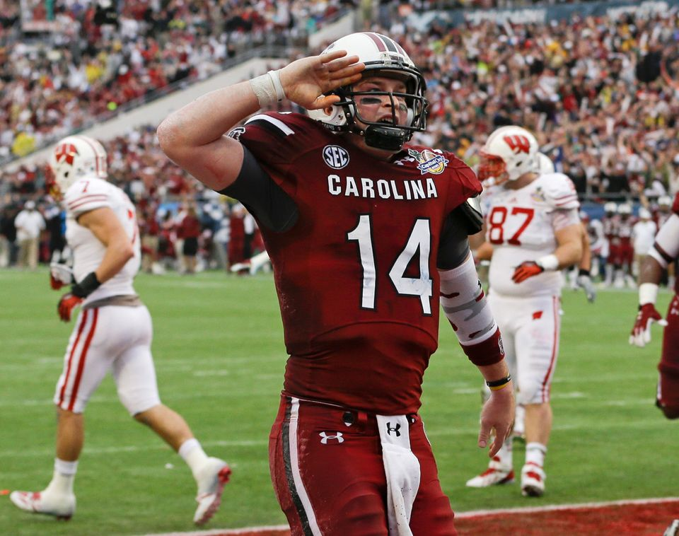 South Carolina quarterback Connor Shaw (14) salutes towards fans after catching a touchdown on a pass from receiver Bruce Ell