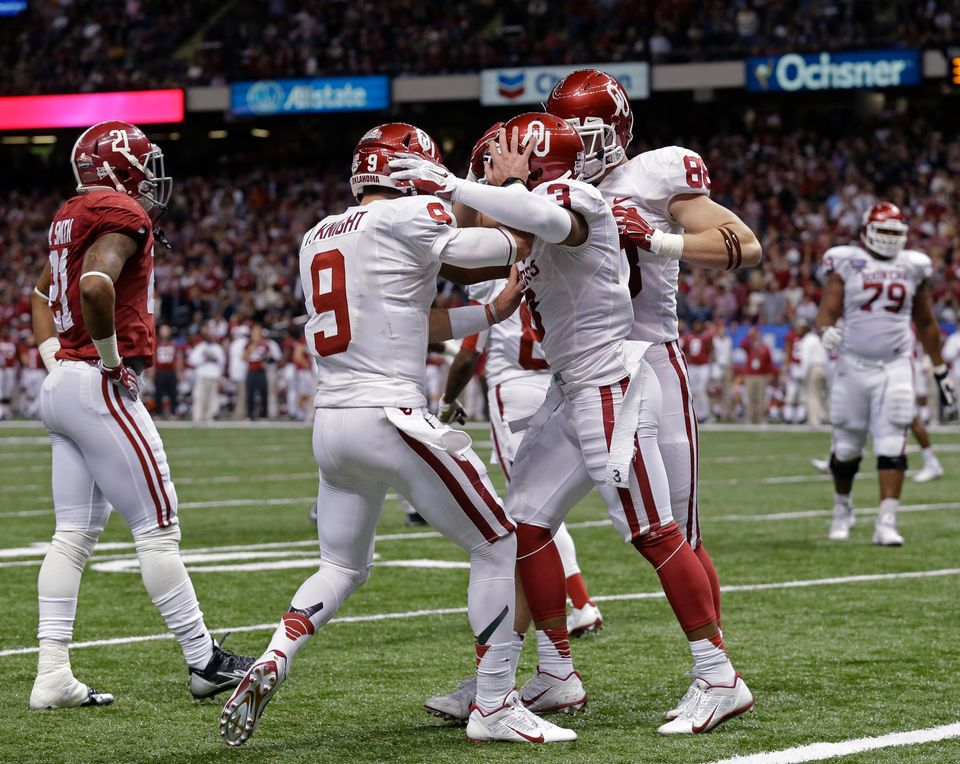 Oklahoma wide receiver Sterling Shepard (3) celebrates his touchdown reception with quarterback Trevor Knight (9) in the seco