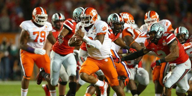 MIAMI GARDENS, FL - JANUARY 03:  Tajh Boyd #10 of the Clemson Tigers runs for a touchdown in the first half against the Ohio