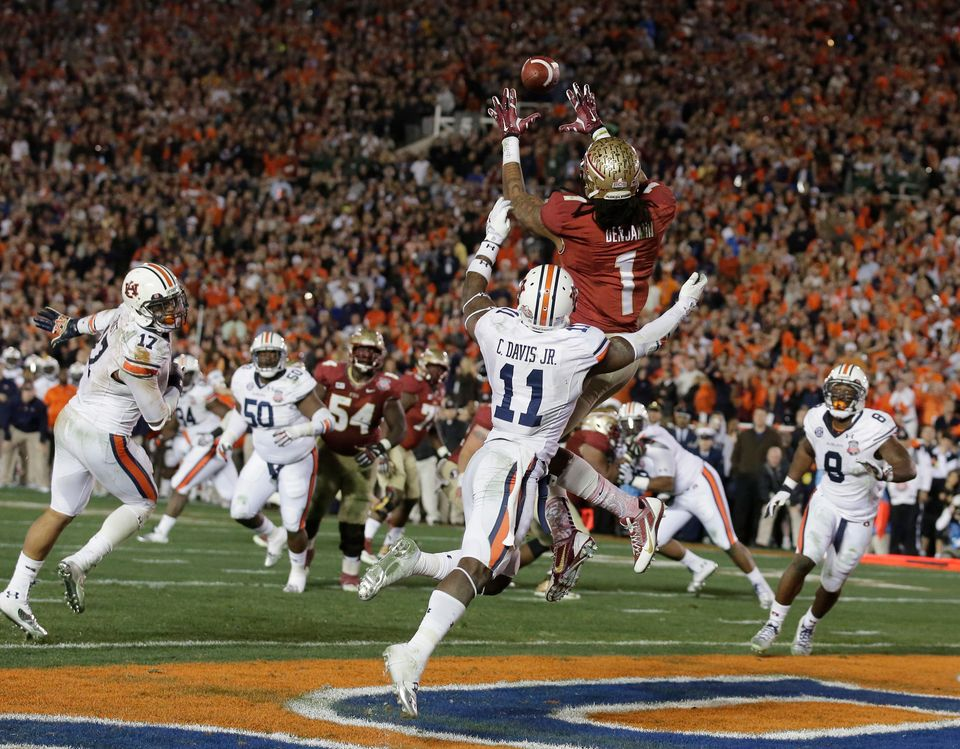 Florida State's Kelvin Benjamin catches the game-winning touchdown pass during the second half of the NCAA BCS National Champ