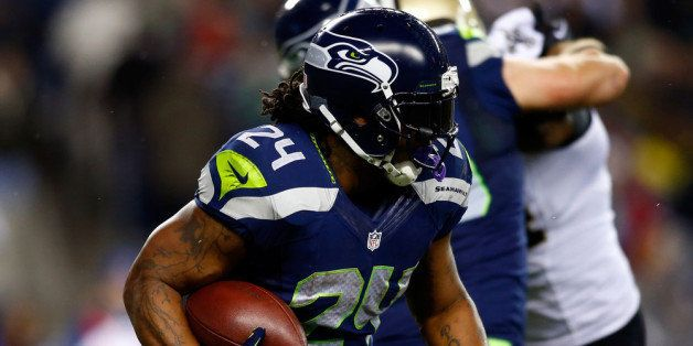 SEATTLE, WA - DECEMBER 02:  Running back Marshawn Lynch #24 of the Seattle Seahawks carries the ball against the New Orleans