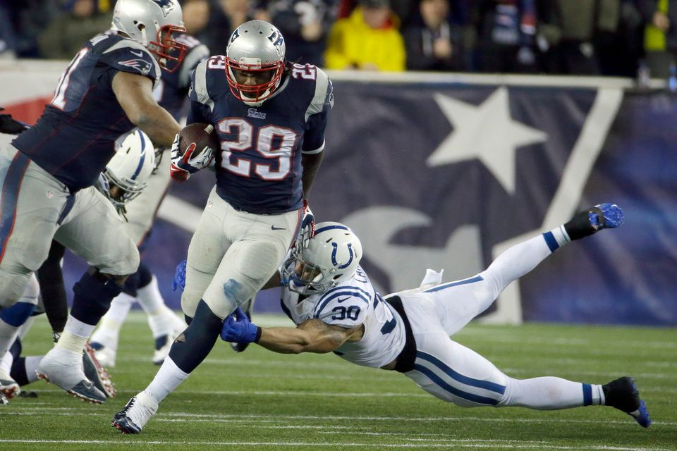 New England Patriots running back LeGarrette Blount (29) breaks free from Indianapolis Colts safety LaRon Landry (30) and hea