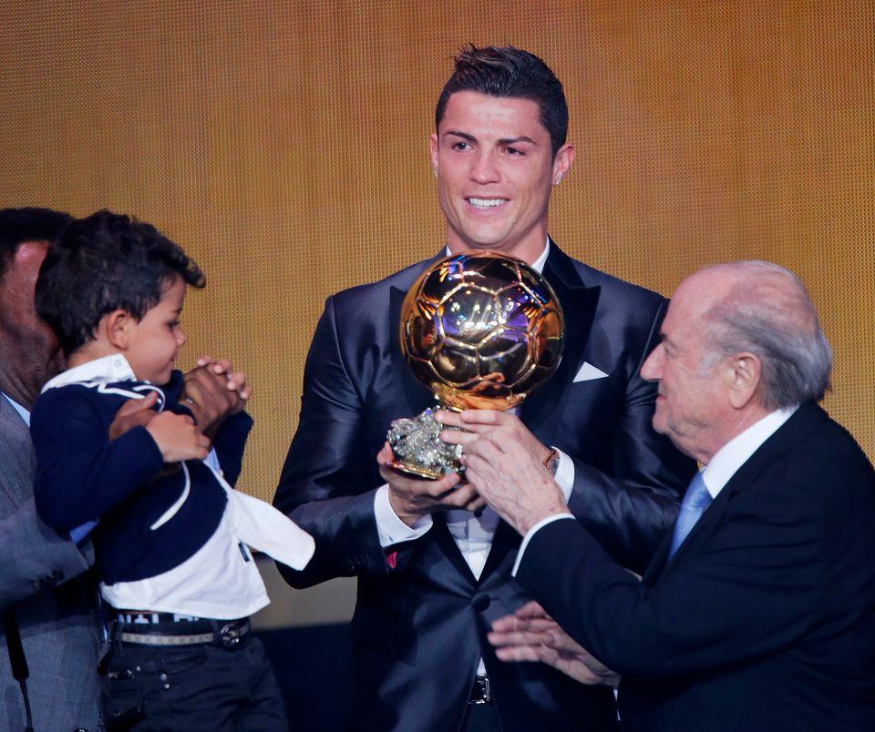 Real Madrid's world player Christiano Ronaldo of Portugal, center, FIFA President Joseph Blatter and Ronaldo's son Ronaldo Ju
