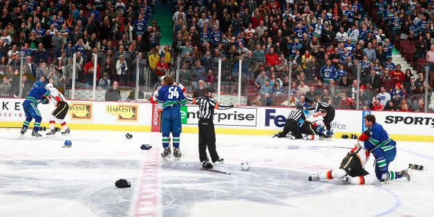 VANCOUVER, BC - JANUARY 18:  A line brawl between the Vancouver Canucks and the Calgary Flames broke out at the start of  the