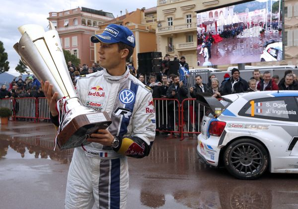 <br>French driver Sebastien Ogier, newly-crowned world champion, looks at the trophy as he celebrates his victory in the 82nd