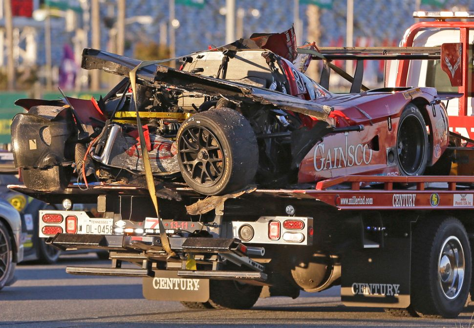 <br>The GAINSCO Corvette DP is hauled away on a wrecker after driver Memo Gidley was involved in a crash during the IMSA Seri