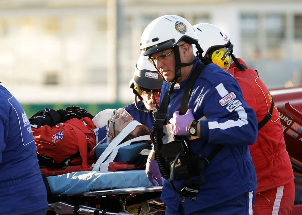 <br>Rescue workers move driver Memo Gidley, center, to an ambulance after he was involved in a crash during the IMSA Series R