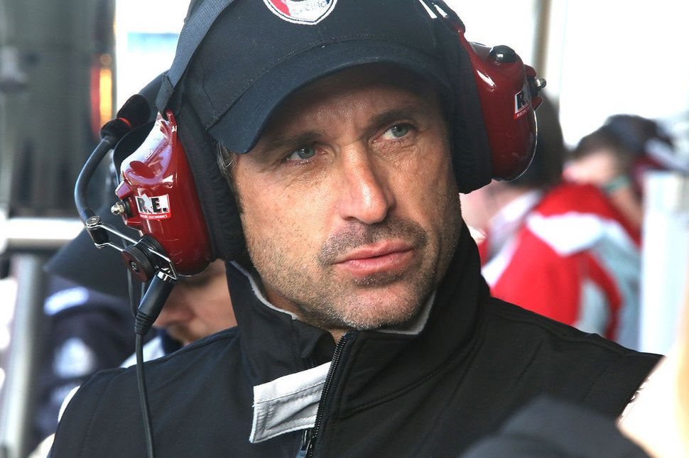 <br>Patrick Dempsey, co-driver of the #27 Dempsey Racing Porsche 911 GT America waits in the pit area during practice for the