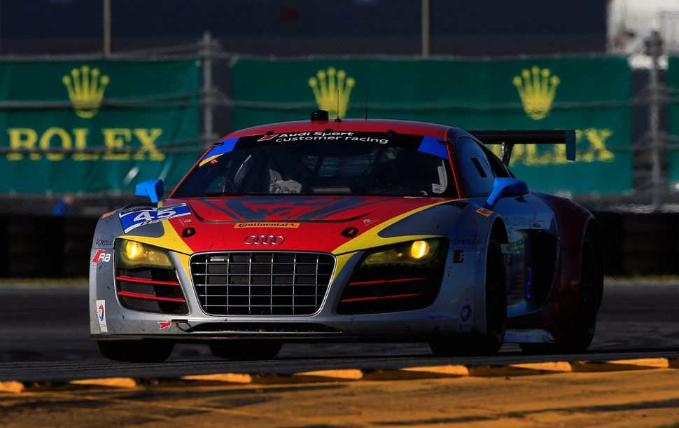 <br>The #45 Flying Lizard Motorsports driven by Nelson Canache Jr, Spencer Pumpelly, Tim Pappas and Markus Winkelhock races d