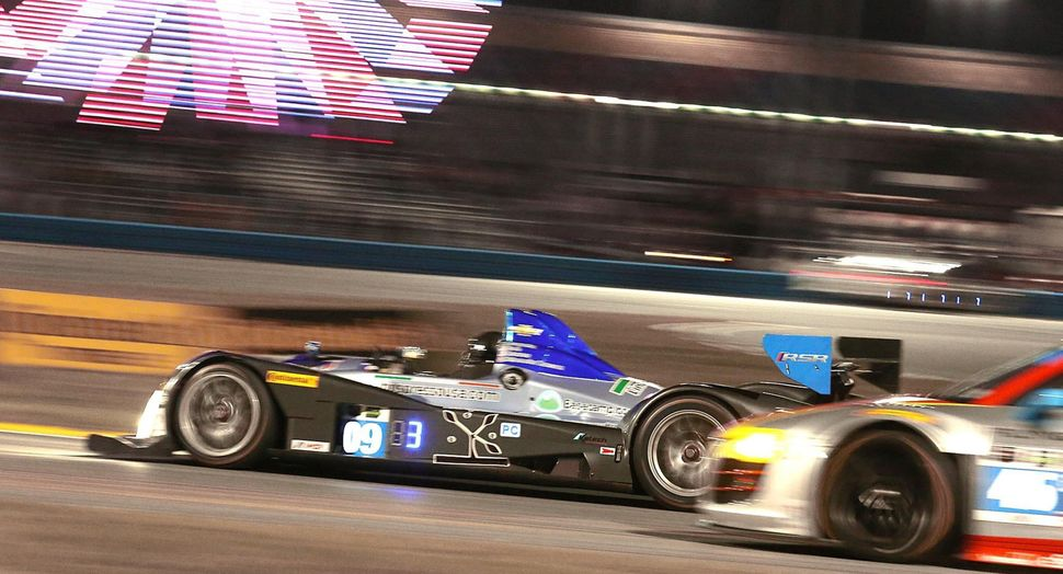 <br>Race cars under the lights during practice for the Rolex 24 at Daytona International Speedway on Thursday, Jan. 23, 2014.