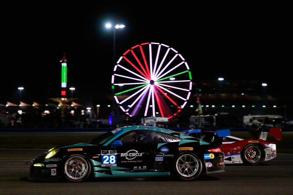 <br>The #28 Dempsey Racing Porsche 911 GT America driven by Christian Engelbert, Rolf Ineichen, Klaus Bachler, Lance Wilsey a