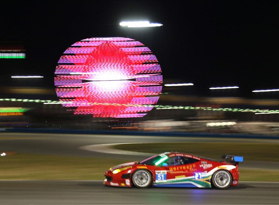 <br>The #51 Spirit of Race Ferrari 458 Italia driven by Matt Griffin, Marco Cioci, Michele Rugolo and Jack Gerber races durin