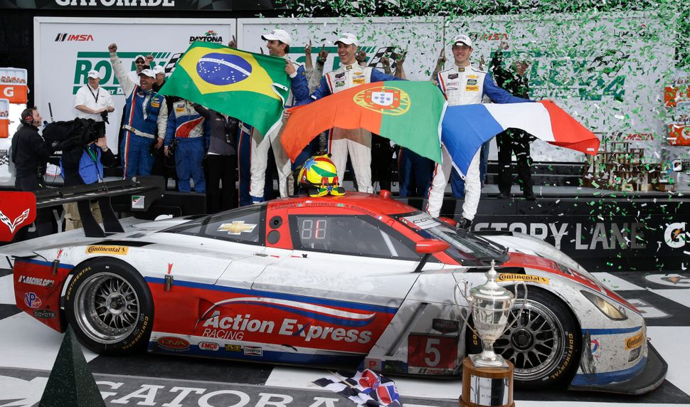 <br>The Action Express team, from left, Christian Fittipaldi, of Brazil, Joao Barbosa, of Portugal and Sebastien Bourdais, of