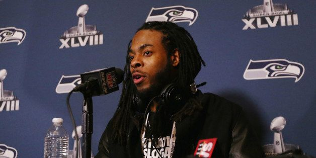 JERSEY CITY, NJ - JANUARY 26:  Richard Sherman of the Seattle Seahawks addresses the media at the Westin Hotel on January 26,