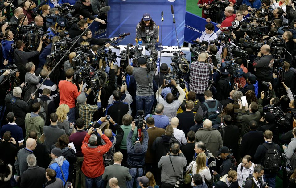 Seattle Seahawks' Richard Sherman answers a question during media day for the NFL Super Bowl XLVIII football game Tuesday, Ja