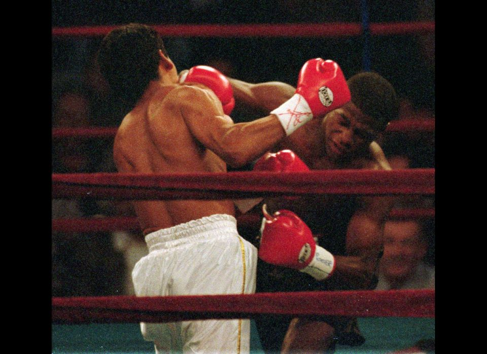 Olympic medalist Floyd Mayweather of Grand Rapids, Mich., right, lands a right to the face of Roberto Apodaca of El Centro, C