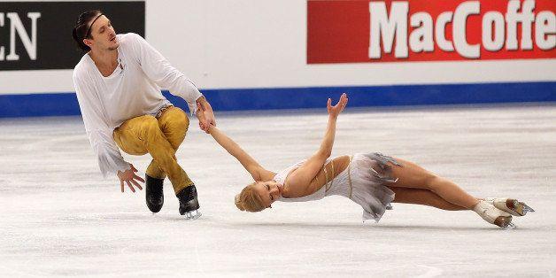 BUDAPEST, HUNGARY - JANUARY 19: Tatiana Volosozhar and Maxim Trankov of Russia (center) win the gold medal in the Pairs Skati