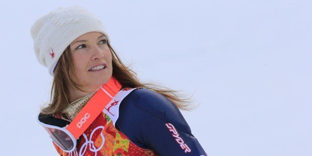 US skier Julia Mancuso poses on the podium after the Women's Alpine Skiing Super Combined Flower Ceremony at the Rosa Khutor