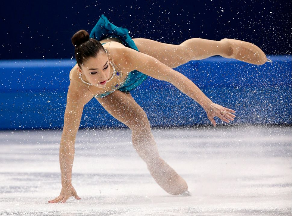 Gabrielle Daleman of Canada falls as she competes in the women's free skate figure skating finals, at the Iceberg Skating Pal