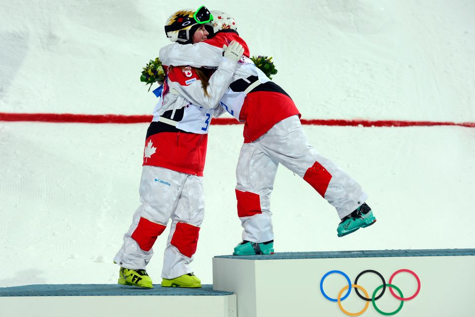 Silver Medallist Canada's Chloe Dufour-Lapointe (L) hugs sister Gold Medallist, Canada's Justine Dufour-Lapointe on the podiu