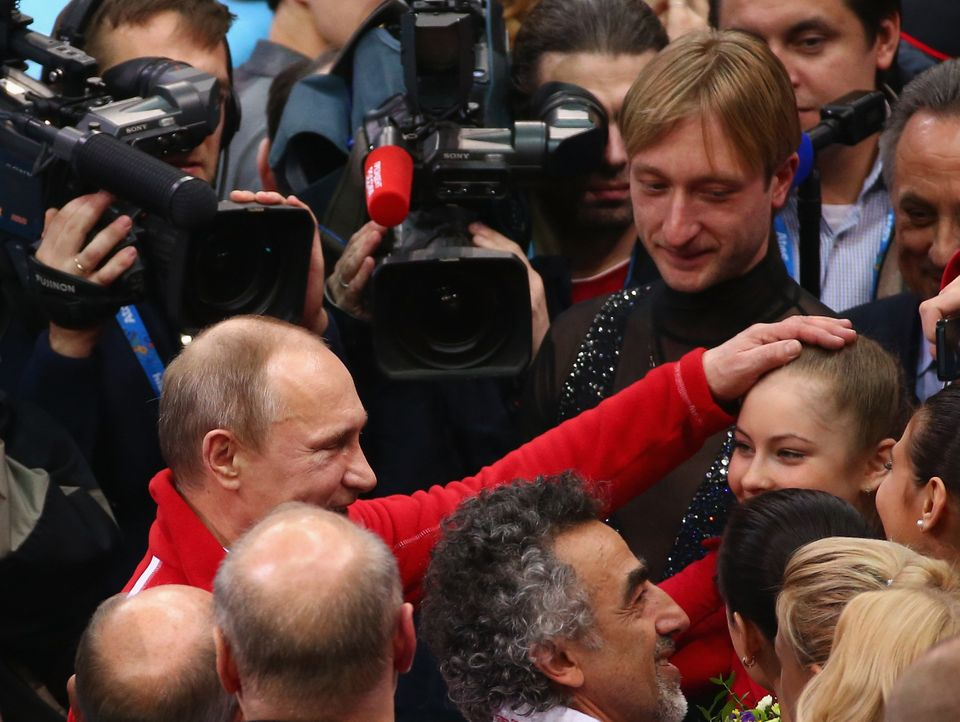 SOCHI, RUSSIA - FEBRUARY 09:  Russian President Vladimir Putin congratulates Yulia Lipnitskaya of Russia after the Team Figur