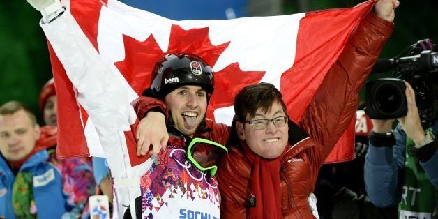 Canada's Alex Bilodeau celebrates his gold medal with his brother Frederic at the Men's Freestyle Skiing Moguls final at the