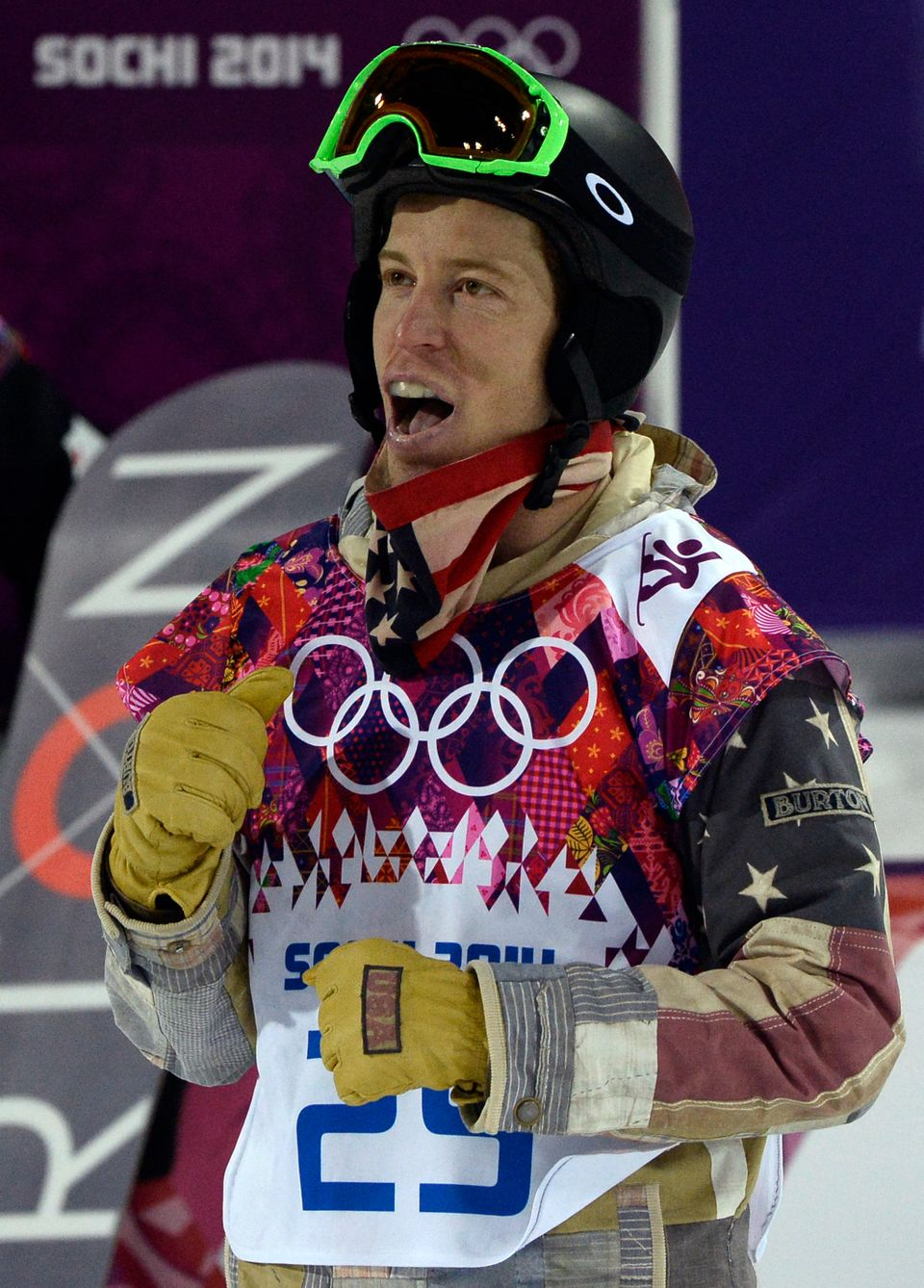 US Shaun White watches his score  in the Men's Snowboard Halfpipe Final at the Rosa Khutor Extreme Park during the Sochi Wint