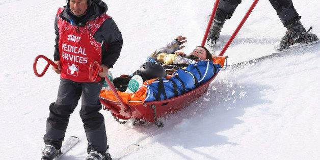 Sochi, Russia - February 16  -  SSOLY- American Jacqueline Hernandez gets brought down the hill after a crash in qualifiers.