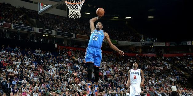 Oklahoma City Thunder's Kevin Durant dunks the ball against the Philadelphia 76ers, during the NBA Global Games at the Phones
