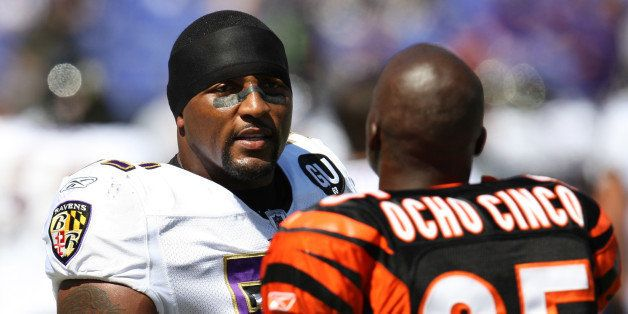 BALTIMORE - SEPTEMBER 7: Linebacker Ray Lewis #52 of the Baltimore Ravens speaks with Chad Ocho Cinco #85 of the Cincinnati B