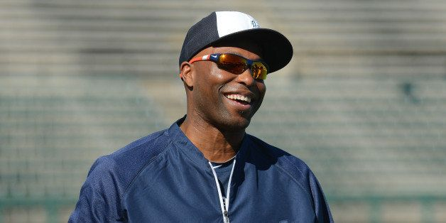 LAKELAND, FL - FEBRUARY 18:  Torii Hunter #48 of the Detroit Tigers looks on and smiles during the spring training workout da
