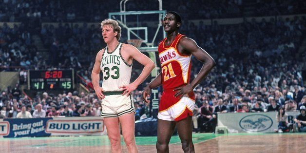 BOSTON - 1983:  Dominique Wilkins #21 of the Atlanta Hawks and Larry Bird #33 of the Boston Celtics stand on the court during